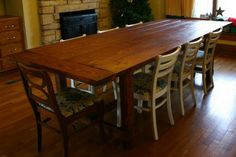 Kelly made Ana-Whites farmhouse table for our house! We have chairs from the 1800's and a large king chair from Craigslist ! The center piece of our house.