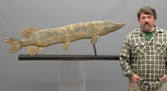 """Large Pike fish weathervane in worn gold patina. 56"""" L., 16 1/2"""" Ht.."""