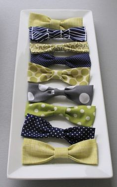Bow tie party favors for a preppy boy shower. Would be cute to add an old fashioned candy stick to the backside of the tie as a little to-go treat for guests.    If you guys have a boy....i'm soooo dressing him like a preppy old man....YES!