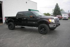 nice lifted Black Ford F-150