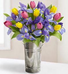 Iris and Tulips but in a pink polka dot vase....