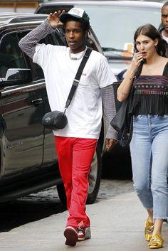 ASAP Rocky wearing Dior Crossbody, Nike Off-White x Air Jordan 1