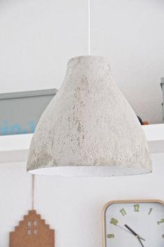 DIY Concrete lamp I got this great idea for pimping my old Ikea lamp from Pinterest and I wanted to try it myself. A DIY concrete lamp above the girls desk