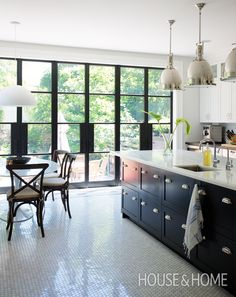 Classic Bistro-Style Kitchen Packed With Storage | Architect Gillian Green gave a small, dated kitchen an update in both form and function thanks to bistro-style finishes, smart storage options and a 250-square-foot addition. Take a look: http://houseandhome.com/tv/segment/otv-monday-gillian-green