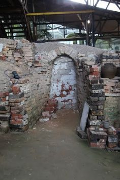 """One of the last Dragon Kilns in Singapore - """"Pots are loaded into the kiln through a number of entrances, which are seal off before the kiln is lit."""""""