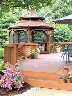 Gazebo integrated into the deck. Beautiful hardwood.
