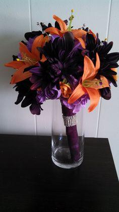 Orange lily and plum bouquet with diamond cuff.