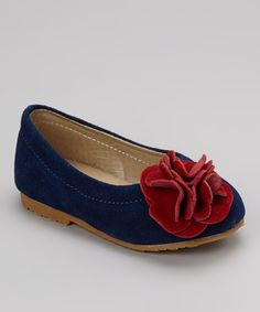 Spiff up any little look with a pair of sweet, flower-topped flats. Boasting a darling duo of hues and genuine suede upper, these slip-ons will steep tiny toes in style.  Zulily
