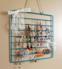 oven rack jewelry organizer. would work with lighter weight cooling racks, too!