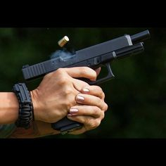 Glock. I love the fact that this girls fingernails are painted, meaning that you can be girly and still shoot a gun. ❤️