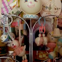 Old baby rattle store display with carefully collected rattles and toys