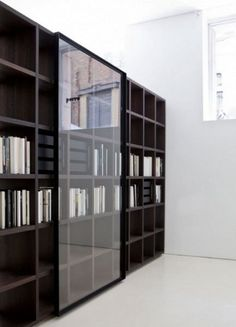 modern bookcase with glass door: mesmerizing bookcase design with new glass sliding doors