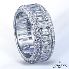 JB Star Platinum Diamond Eternity Band handcrafted of 27 carefully matched baguettes in channel setting framed in millegrain edge and round diamonds...
