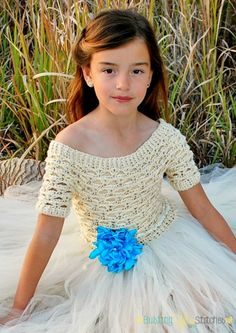 This fun crochet dress works up fast using worsted weight yarn and the free pattern is available to view here! All you need is yarn, a hook, and tulle.