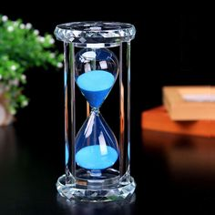 Hourglass timer  with blue sand. Comes in a beautiful #gift box. #kitchen