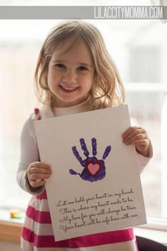 use heart sticker under handprint and peel it away.....Handprint in Heart Keepsake