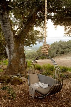 cool metal hammock, this looks so comfy! and that view would keep me here for days!