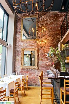 Ove the exposed brick wall. Mucca Osteria, Italian Restaurant in Portland, Oregon.