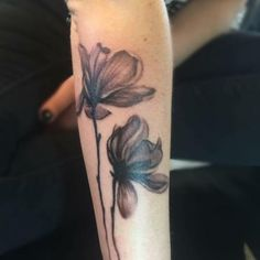Black and grey flower tattoo By Loretta Thomason at Rave'N Ink
