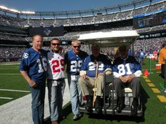 Frank Gifford, Alex Webster, Andy Robustelli (accompanied by Webster's grandsons). 2011. The NY Giant alums flipped the pre-game coin, Giants vs. Lions