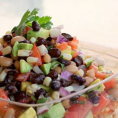 Cowboy Caviar: 1 can black eyed peas, drained and rinsed, 1 can black beans, drained and rinsed,1 can shoepeg corn, drained and rinsed, 4-5 Roma tomatoes, seeds removed and diced, 2-3 diced avocados, ripe but still firm, 4 green onions, sliced thin (I used 1/2 purple onion diced finely because that's all I had), around 1/2 to 3/4 cup Zesty Italian dressing, 1/2 bunch cilantro, chopped finely,1-2 limes, ground pepper, and salt to taste!