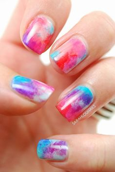 A very pretty and almost frosted like watercolor nail art design. Put together attractive colors such as pink, red, violet, and blue to create this wonderful overlapping color combination.
