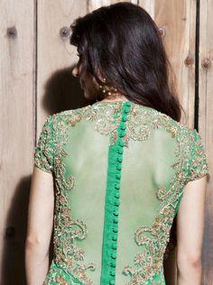A hand embroidered emerald green button down anarkali with a stretch satin churidar and net embroidered dupatta. Available at www.waliajones.com #malasa #malasaofficial #anarkali #georgette #net #dupatta #waliajones