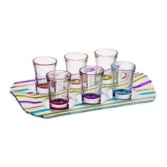 Bring chic style to your tabletop with this eye-catching essential.   Product: 6 Shot glasses and trayConstr...