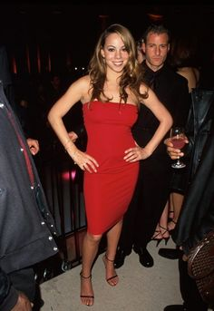 Mariah Carey wears a red dress to a party in the year 2000