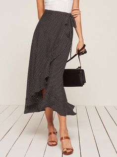 Talk romance to me. This is a midi length, wrap skirt with a ruffle edged hem a… Talk romance to me. This is a midi length, wrap skirt with a ruffle edged hem and high slit. Mode Outfits, Skirt Outfits, Dress Skirt, Fashion Outfits, Ruffle Skirt, Midi Wrap Skirt, Chiffon Skirt, Ruffles, Oktoberfest Outfit