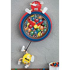 It's always time for mayhem when the M&M'S are in the house! Whimsical pendulum clock features a hapless Yellow hanging on for dear life, as Red looks on from above. $29.98