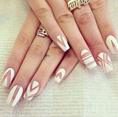 This nail polish natural-nail-color-for-the-patterns style is now becoming the trend. And I don't see any reason why not. From Chevron to stripes and even shapes, all looks stunningly beautiful.