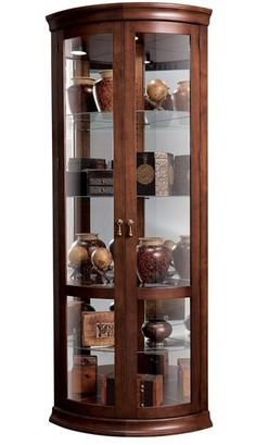 Howard Miller Chancellor Corner Curio Cabinet in Hampton Cherry lines, looks good Corner Display Cabinet, Corner Curio, Tall Cabinet Storage, Glass Curio Cabinets, Crockery Cabinet, Glass Shelves, New Cabinet, China Cabinet, Cabinet Ideas