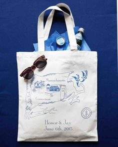 This Blue-and-White Wedding in Connecticut Was Inspired by a China Pattern | Martha Stewart Weddings - Canvas welcome bags screen-printed with a map were filled with snacks, lip balm, and photo-op essentials (namely, tortoiseshell shades labeled on one side with #honorandjaywed and a white disposable camera).