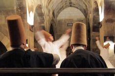 Whirling Dervish Ceremony - Turkey. Since the middle ages, an Islamic religious ritual known as the Sema has been practiced in Turkey. The ceremony consists of dancers that can be seen whirling in repetitive circles while in their white robes. The dance is seen as a symbolic imitation of planets in the solar system revolving around the sun. The music that accompanies the dancers is hypnotic and is lead by the Ney flute player. Click photo to play authentic sound from www.thetouchofsound.com.