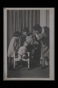 Edith Frank feeding Anne. Her sister Margot and cousin Stephan Elias are watching.
