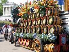oktoberfest decoration httpwwwoktoberfesthauscom barrels with red pansies - Oktoberfest Decorations