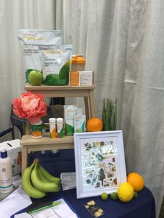 Arbonne product display at a vendor show. Articficial flowers and fruit really make it pop. Protein shake, fizz sticks, 7 day cleans and fibre boost.