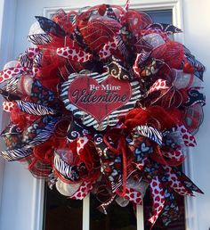 A personal favorite from my Etsy shop https://www.etsy.com/listing/259558797/valentines-day-deco-mesh-wreath