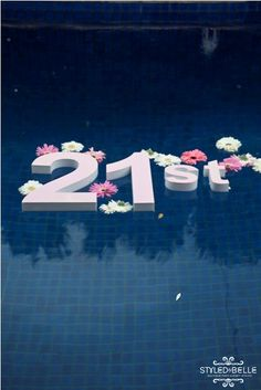 """Styrofoam letters """"Happy 21st Birthday"""" floating in a pool :)"""