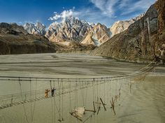 Travelers cross the dilapidated Hussaini Hanging Bridge in northern Pakistan in this National Geographic Photo of the Day.