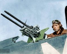 C: The rear gunner of a USMC Douglas SBD Dauntless dive bomber mans his tool of trade allowing for a clear view of the 0.30 in (7.62 mm) Browning machine guns' mounting.