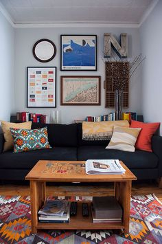 "Sneak Peek: Jason Santa Maria & Megan Born. ""The living room is also painted in Valspar Tibetan Mist. Prints include one from the 1984 Los Angeles Olympics, Great Gatsby Business Cards by The Heads of State and a map of famous rivers and mountains found on Etsy. Jason sewed the pillows with fabric found at Mood. The rug is another Etsy find."" #sneakpeek"