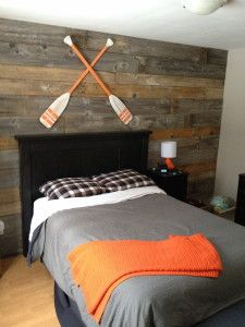 I like the wood accent wall and the black furniture and gray and orange color scheme but definitely no oars