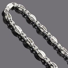 This 14K Mens Diamond Chain Necklace weighs approximately 115 grams and showcases 19.60 ctw of sparkling round and princess cut diamonds.