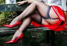 Red upskirt to show grey stockings with red heels.