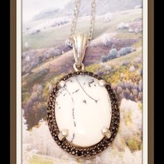"""HP Retail 2/10/16 Dendritic Agate 8.65 CTs Dendritic Agate Pendant, 8.65 CTs. Features an oval cut gem accented with Black Spinel, often called """"The Black Diamond"""". Pendant With Chain (20 in) in Platinum Overlay .925 Sterling Silver Nickel Free.TGW 9.053 Cts. No two dendrite gemstones will ever be alike, so you'll be getting a totally unique gemstone in each piece of jewelry. Your stone will tell its own fascinating story of how it formed. Different colors and patterns will be evident in…"""