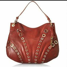 "Cole Haan red leather ""Whitney""  zip hobo Dark red/Merlot leather shoulder bag. Never worn. Goldtone hardware. Shoulder strap; 12"" drop. Zip top. Hanging ""Cole Haan"" tag. Angled rows of grommets in ascending sizes on front. Cole Haan Bags Hobos"