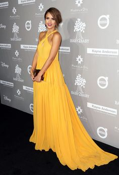 Best Dressed at Baby2Baby Gala- Jessica Alba brightened up the carpet in a yellow floor-skimming frock with a cross-over halter top and key-hole cut-out.