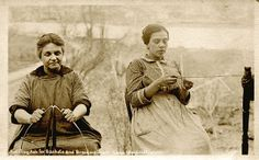 Penobscot women from Indian Island, in Old Town, Maine. One is splitting ash for baskets, the other is weaving sweetgrass. Circa 1920.